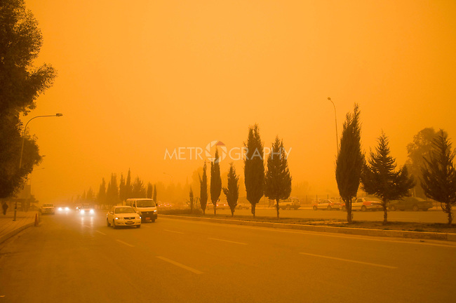 ERBIL, IRAQ: A street in Erbil is blinded by a sandstorm...The first sandstorm of the season hits northern Iraq...Photo by Metrography