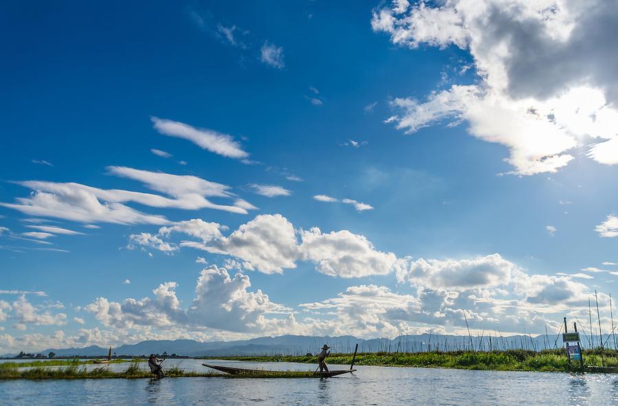 INLE LAKE, MYANMAR - CIRCA DECEMBER 2013: Men working on floating islands in Inle Lake.