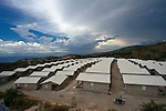 """A model resettlement village constructed by the Lutheran World Federation in Gressier, Haiti. The settlement houses 150 families who were left homeless by the 2010 earthquake, and represents an intentional effort to """"build back better,"""" creating a sustainable and democratic community."""