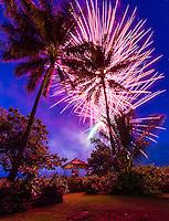 A couple enjoys the fireworks on the beach on Independence Day, Waialua Beach, O'ahu.