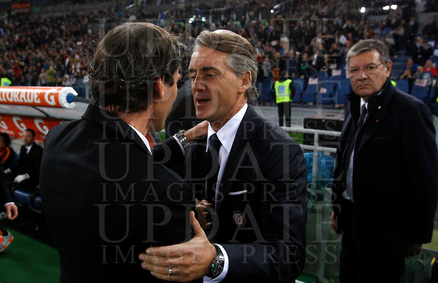 Calcio, Serie A: Roma vs Inter. Roma, stadio Olimpico, 30 novembre 2014.<br /> Roma&rsquo;s coach Rudi Garcia, left, and  Roberto Mancini shake hands prior to the start of the Italian Serie A football match between AS Roma and FC Inter at Rome's Olympic stadium, 30 November 2014.<br /> UPDATE IMAGES PRESS/Riccardo De Luca