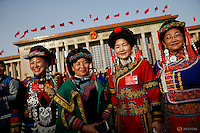 Ethnic minority delegates pose for pictures outside the Great Hall of the People ahead of the opening session of the National People's Congress (NPC) in Beijing, China, March 5, 2016. REUTERS/Damir Sagolj