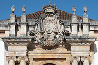 Coat of arms over the main entrance to the Joanina Library, or Biblioteca Joanina, a Baroque library built 1717-28 by Gaspar Ferreira, part of the University of Coimbra General Library, in Coimbra, Portugal. The Casa da Livraria was built during the reign of King John V or Joao V, and consists of the Green Room, Red Room and Black Room, with 250,000 books dating from the 16th - 18th centuries. The library is part of the Faculty of Law and the University is housed in the buildings of the Royal Palace of Coimbra. The building is classified as a national monument and UNESCO World Heritage Site. Picture by Manuel Cohen