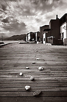 Taken at the beach of the small village of Varigotti on the Ligurian coast, Italy. It was noon and lunch time, thus the beach was all for me alone. Some kids had probably played with those pebbles earlier in the morning... I didn't arrange the scene since the pebbles were already displaced in a very nice way.