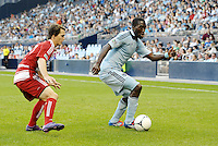 Sporting KC forward CJ Sapong (17) marked by FC Dallas defender Zach Loyd... Sporting KC defeated FC Dallas 2-1 at LIVESTRONG Sporting Park, Kansas City, Kansas.