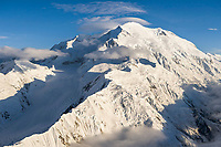 Aerial view of Mount McKinley, view looking west along Pioneer ridge and the North summit in view. High wind Lenticular clouds over the North summit.