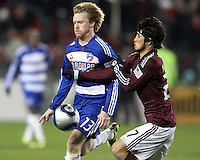 Dax McCarty#13 of FC Dallas pushes the ball past Kosuke Kimura#27 of the Colorado Rapids during MLS Cup 2010 at BMO Stadium in Toronto, Ontario on November 21 2010. Colorado won 2-1 in overtime.