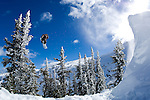 Professional snowboarder Romain De Marchi snowboarding in the Coast Range Mountains of British Columbia, Canada.
