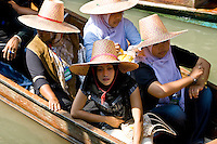 Women in a boat visiting the Damnern Saduak floating market, Bangkok, Thailand