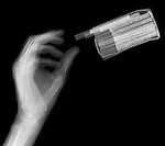 X-ray image of reaching for cigarettes (white on black) by Jim Wehtje, specialist in x-ray art and design images.