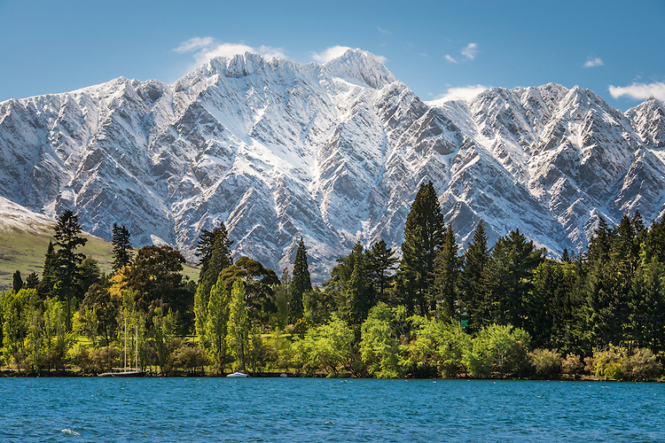 View across Lake Wakatipu, towards the Gardens with snow on the Remarkables, Queenstown, New Zealand - stock photo, canvas, fine art print