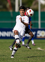 Alejandro Guido (10) of the United States passes the ball upfield during the quarterfinals of the CONCACAF Men's Under 17 Championship at Catherine Hall Stadium in Montego Bay, Jamaica. The USA defeated El Salvador, 3-2, in overtime.