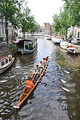 Amsterdam is a colorful city of canals rimmed with 17th century architecture, and abounding with bicycles and bouquets of vibrant blooms.