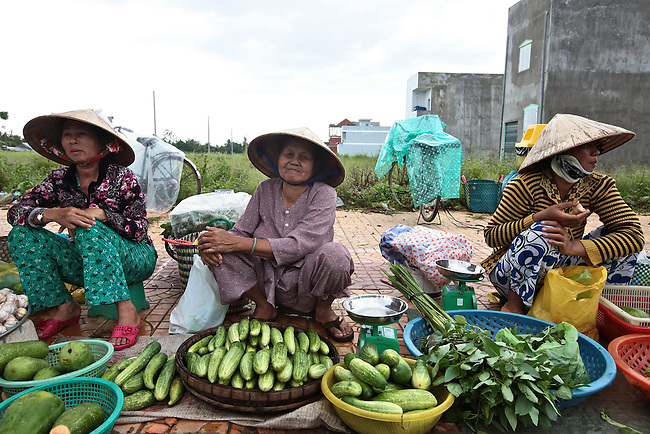 Women sell vegetables in the town of Cai Rang, in the Mekong Delta, Vietnam. Sept. 30, 2011.