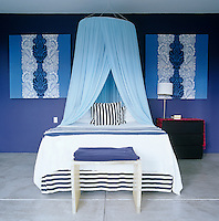 Stripes and classical motifs ring the changes in the blue colour scheme of this contemporary bedroom