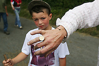 23/6/2009. Spancill Hill horse fair. Dennis O Shea shows his gold ring also pictured is his 7 year old son Daniel from Cork are pictured at the Spancill Hill horse Fair Co Clare.At one time, Spancill hill was said to be Ireland's largest fair with buyers from Britain, Russia, Prussia, and France competing to purchase the best stock for their Imperial armies. Recently the fair has been revived and is now going from strength to strength..Spancill Hill is also traditional Irish folk song which bemoans the plight of the Irish immigrants who so longed for home from their new lives in America, many of them who went to America with the Gold Rush.This song is sung by a man who longs for his home in Spancill Hill, his friends and the love he left there. All the characters and places in this song are real. Picture James Horan/Photocall Ireland
