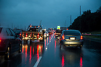 A rain storm ads extra commute time for commuters on Mopac Expressway (Loop 1) morning traffic jam in downtown Austin, Texas.