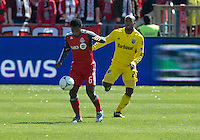 31 March 2011: Toronto FC midfielder Julian de Guzman #6 and Columbus Crew forward Emilio Renteria #20 in action during a game between the Columbus Crew and the Toronto FC at BMO Field in Toronto, Ontario Canada.
