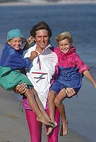 Bruce Jenner carrying sons Brody (left) and Brandon, Malibu California, September, 1988. Photo by John G. Zimmerman