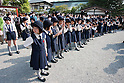 April 11, 2011, Kamakura, Japan - A large group of young Japanese girls attend a special commemorative event at Hachimangu Shrine to offer prayers for the relief of the March 11 earthquake and tsunami victims. Today is exactly one month since the devastating disaster that left Tohoku with almost nothing to spare. (Photo by Christopher Jue/AFLO) [2331].