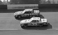 Eventual winner Harry Gant (33) battles with Tim Richmond (27) for the lead during the Southern 500 at Darlington Raceway in Darlington, SC on September 2, 1984. (Photo by Brian Cleary/www.bcpix.com)