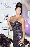 Amy Childs.The photocall to launch her debut fragrance in collaboration with Jigsaw, Aura bar & nightclub, London, England..August 15th, 2012.half length purple strapless dress  sequins sequined hair up bun  .CAP/CAN.©Can Nguyen/Capital Pictures.