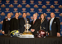 Michigan head coach Brady Hoke, Virginia Tech Frank Beamer and Sugar Bowl Committee staff pose together with the Sugar Bowl trophy for group photos during Head Coaches Press Conference at Marriott Hotel at the Convention Center on January 2nd, 2012.
