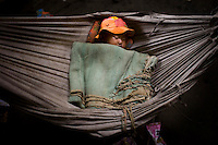 An infant from the 7th ward, Hlaingthaya township in Rangoon (Yangon) sleeps in the Shwe Than Lwin shopping complex after Cyclone Nargis hit the Irrawaddy Delta on 02/05/2008. The building is under construction and has acted as a small refugee centre.