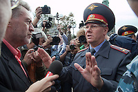 Moscow, Russia, 22/08/2010. .Police attempt to prevent legendary Russian rock star Yuri Shevchuk, veteran rock journalist Artemy Troitsky &amp; ecological activist Yevgenia Chirikova from entering Pushkin Square, where some 3,000 people gathered for a concert and protest against the destruction of part of Khimki Forest in northern Moscow as part of a motorway project. The concert was banned and police seized the performers' musical equipment, but unusually the anti-government protest was allowed to take place, although a number of opposition organisers were arrested on their way to the demonstration.