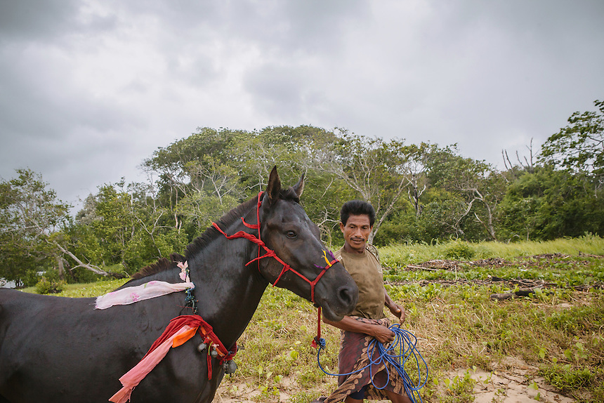 Johanes Ndara Kepala, a senior Pasola warrior after bathing his horse in Waiha river, near his village Wainyapu, Kodi. Pasola is an ancient tradition from the Indonesian island of Sumba. Categorized as both extreme traditional sport and ritual, Pasola is an annual mock horse warfare performed in response to the harvesting season. In the battelfield, the Pasola warriors use blunt spears as their weapon. However, fatal accident still do occurs.
