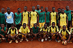 AS Pelican FC pose for a photos after a training match on a pitch next to the military airport. Yaounde, Cameroon.
