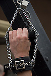 "S&M flogging close up of slaves chained hand on rack.  Folson Street East S&M Fair in New York City. Master / Slave Cathartic Flogging scene.The flogging brings out a release of emotions usually by a crying. Hugging is the ""aftercare"" where the slave feels safe and protected."