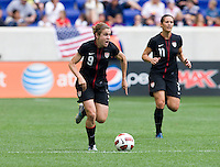 Heather O'Reilly (9) of the USWNT  carries the ball upfield during the game at Red Bull Arena in Harrison, NJ.  The USWNT defeated Mexico, 1-0.