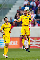 Josh Williams (3) of the Columbus Crew goes up for a header with Markus Holgersson (5) of the New York Red Bulls. The New York Red Bulls and the Columbus Crew played to a 2-2 tie during a Major League Soccer (MLS) match at Red Bull Arena in Harrison, NJ, on May 26, 2013.
