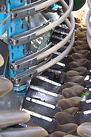 Mechanical harvesting tractor. Interior with conveyor belt and vibrating bars. Chateau de Haux, Bordeaux, France