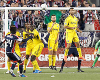 Columbus Crew midfielder Tony Tchani (6), Columbus Crew forward Eddie Gaven (12), and Columbus Crew midfielder Justin Meram (9) react to New England Revolution free kick. In a Major League Soccer (MLS) match, the New England Revolution tied the Columbus Crew, 0-0, at Gillette Stadium on June 16, 2012.