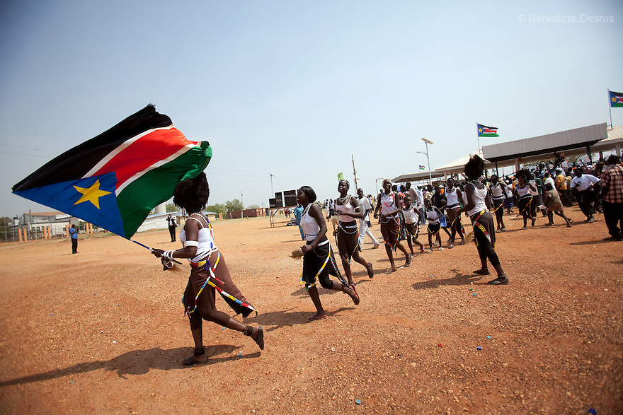 9 december 2010 - Juba, South Sudan - Southern Sudanese citizens march in the streets in support of the independence referendum in Juba, South Sudan. According to South Sudanese officials, more than 2.8 million people have registered to vote in the referendum. The referendum on whether the oil-producing region should declare independence, scheduled for Jan. 9, is the climax of a 2005 peace deal that ended decades of north-south conflict - Africa's longest civil war that was fought over ethnicity, religion, ideology and oil and that killed 2 million people. Photo credit: Benedicte Desrus