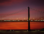 San Francisco Oakland Bay bridge at sunrise with street lights and bridge lights, San Francisco, California USA