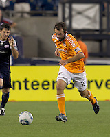 Houston Dynamo midfielder Adam Moffat (16) brings ball out. In a Major League Soccer (MLS) match, the New England Revolution tied Houston Dynamo, 1-1, at Gillette Stadium on August 17, 2011.