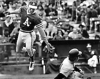 "Oakland Athletics Bert ""Campy"" Campaneris leaps to grab high throw as N.Y Yankee Bobby Mercer steals 2nd base. (1972 photo by Ron Riesterer)"