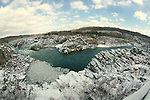 A fisheye view of the Great Falls of the Potomac under a inch of snow.