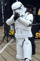 A Stormtrooper takes aim at the Santa Monica Pier during Course of the Force on Saturday, July 7, 2012. Course of the Force is an Olympic-style lightsaber relay, where participants are making a journey from Santa Monica to San Diego while benefiting the Make-A-Wish Foundation. At quarter-mile markers (much less than 12 parsecs), participants hand off the official Course of the Force lightsaber to the next runner as they begin their leg of the journey. Course of the Force is taking place July 7-11, in the days leading up to the annual San Diego Comic Con International.
