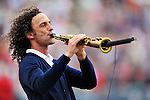 6 March 2011: Contemporary jazz saxophonist Kenneth Bruce Gorelick, known as Kenny G, plays the National Anthem prior to a Spring Training game between the Atlanta Braves and the Washington Nationals at Space Coast Stadium in Viera, Florida. The Braves shut out the Nationals 5-0 in Grapefruit League action. Mandatory Credit: Ed Wolfstein Photo