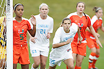 05 November 2008: Miami's Paulelett Ricks-Chambers (5) guards the near post, as North Carolina's Tobin Heath (98) looks to get open prior to a UNS corner kick. The University of North Carolina defeated the University of Miami 1-0 at Koka Booth Stadium at WakeMed Soccer Park in Cary, NC in a women's ACC tournament quarterfinal game.