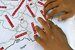 A boy who is blind reads a map with Braille lettering during class in a school in Zipolite, a town in Oaxaca, Mexico.