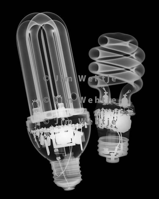 X-ray image of two compact fluorescent lamps (white on black) by Jim Wehtje, specialist in x-ray art and design images.