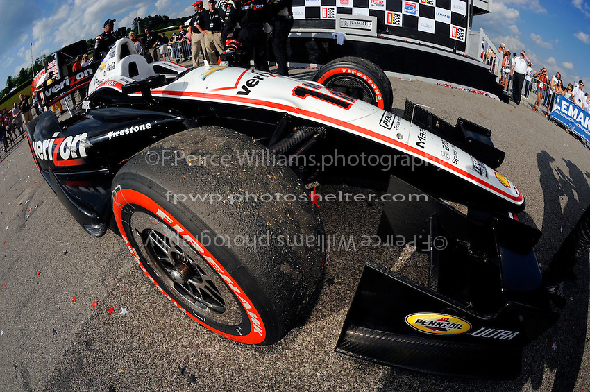 Rubber build up of the tires of Will Power's (#12) winning car.