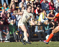 Boston College defender Zoe Lombard (20) clears the ball. .After two overtime periods, Boston College (gold) tied University of Miami (orange), 0-0, at Newton Campus Field, October 21, 2012.