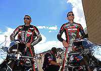 Jul, 22, 2012; Morrison, CO, USA: NHRA pro stock motorcycle rider Eddie Krawiec (left) and teammate Andrew Hines during the Mile High Nationals at Bandimere Speedway. Mandatory Credit: Mark J. Rebilas-US PRESSWIRE
