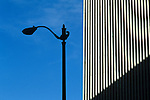 Silhouetted lamp post with  building on a sunny afternoon downtown Seattle Washington State uSA
